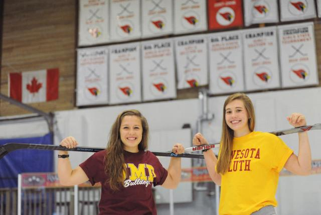 Alexandria junior McKenzie Revering (left) and senior Lauren Niska wear their University of Minnesota-Duluth gear on the ice at the Runestone Community Center on October 15. Both players recently gave verbal commitments to play their college hockey for the Bulldogs.
